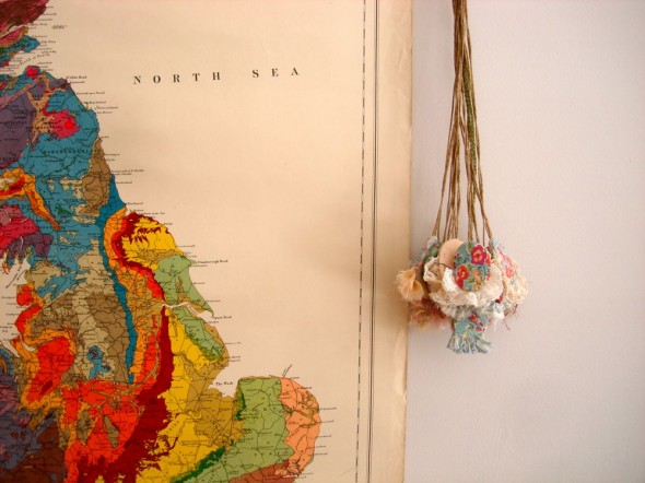 Pendants on vintage map