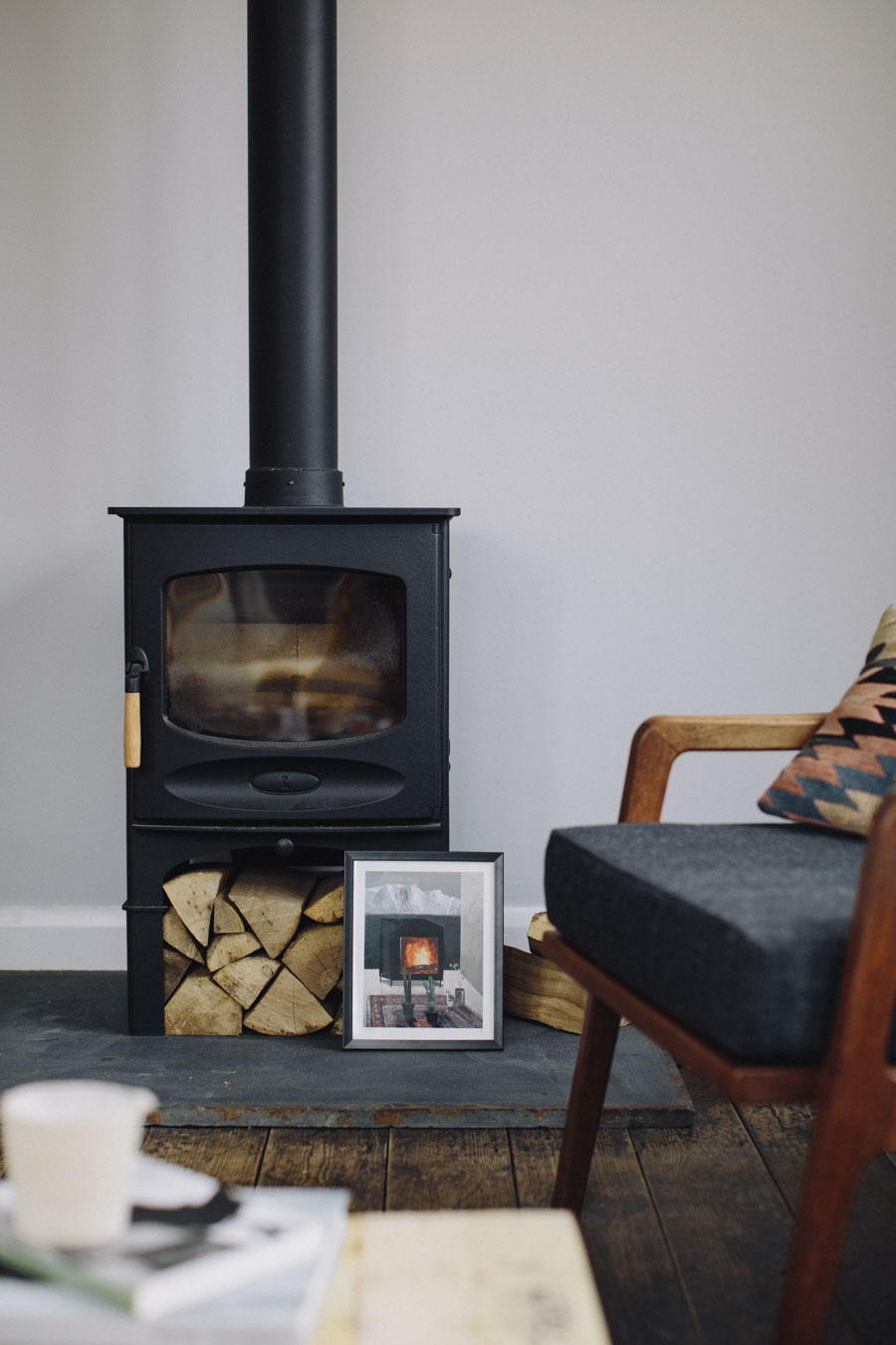 Wood burning stove and grey walls