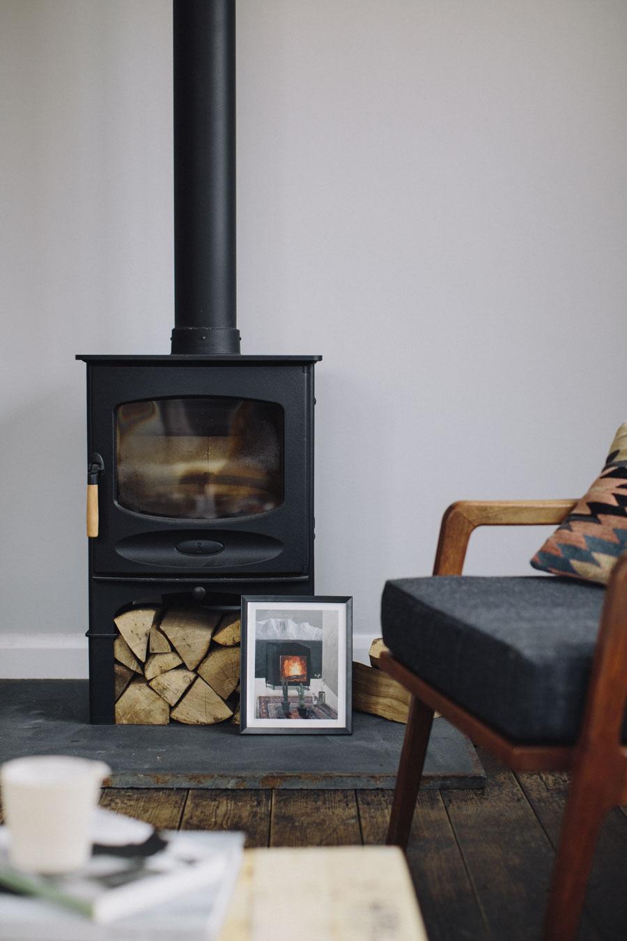 Wood burning stove and grey walls
