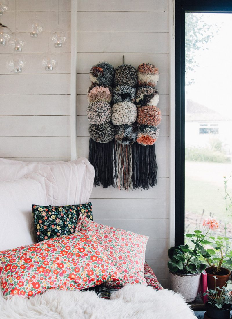 Giant pom pom wall hanging