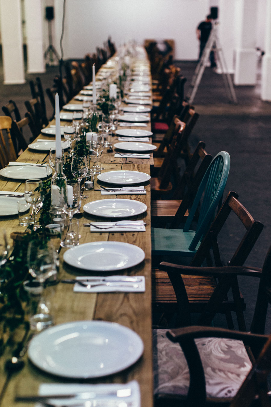 Mismatched chairs for rustic dinner