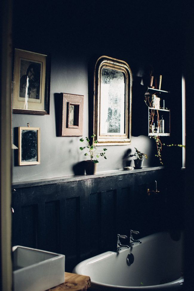 Moody bathroom with gold accents