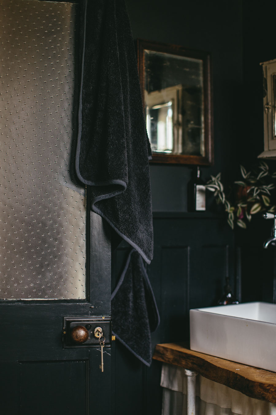 Dark bathroom styling